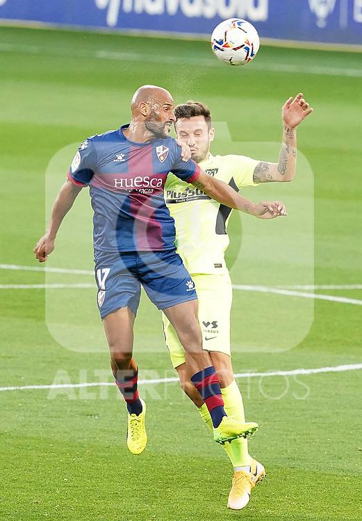 SD Huesca's Mikel Rico (l) and Atletico de Madrid's Saul Niguez during La Liga match. September 30,2020. (ALTERPHOTOS/Acero)