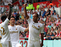 Saturday, 01 September 2012<br /> Pictured: Wayne Routledge of Swansea (R) celebrating his equaliser with team mates Nathan Dyer (L) and Danny Graham (C).<br /> Re: Barclays Premier League, Swansea City FC v Sunderland at the Liberty Stadium, south Wales.