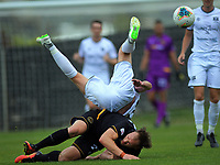 Bill Robertson fouls Hamish Watson during the ISPS Handa Premiership football match between Team Wellington and Hawkes Bay United at David Farrington Park in Wellington, New Zealand on Sunday, 12 January 2020. Photo: Dave Lintott / lintottphoto.co.nz