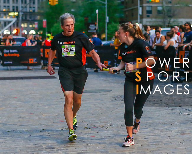 The Extra Mile 2018 -  Bloomberg chairman hands over the baton as he completes the relay during New York race on 3 May 2018, in New York, USA. Photo by Eduardo Muñoz / Power Sport Images