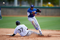 Los Angeles Dodgers minor league infielder Jesmuel Valentin #10 attempts to turn a double play as Courtney Hawkins #37 slides in during an instructional league game against the Chicago White Sox at the Camelback Ranch Training Complex on October 6, 2012 in Glendale, Arizona.  (Mike Janes/Four Seam Images)