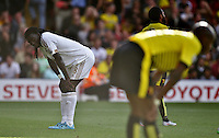 Bafetimbi Gomis of Swansea looks dejected   during the Barclays Premier League match Watford and Swansea   played at Vicarage Road Stadium , Watford