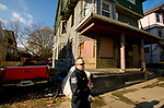 WATERBURY, CT-121917JS05---Waterbury police Capt. Daniel Later looks over some of the homes on Vermont Street in Waterbury on Tuesday. The city has launched a new blight department following a study about the extent of blight. <br /> Jim Shannon Republican-American