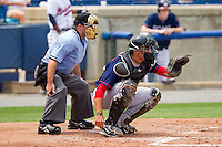 Catcher Cole Leonida #13 of the Hagerstown Suns sets a target as home plate umpire Mike Cascioppo looks on during the game against the Rome Braves at State Mutual Stadium on May 1, 2011 in Rome, Georgia.   Photo by Brian Westerholt / Four Seam Images