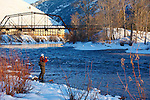 Fisherman in winter on the Clark Fork River in downtown Missoula, Montana