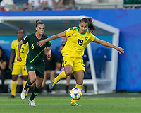 GRENOBLE, FRANCE - JUNE 18: Toriana Patterson #19 of the Jamaican National Team controls the ball as Chloe Logarzo #6 of the Australian National Team defends during a game between Jamaica and Australia at Stade des Alpes on June 18, 2019 in Grenoble, France.