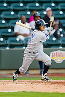 Jack Lopez (11) of the Wilmington Blue Rocks follows through on his swing against the Winston-Salem Dash at BB&T Ballpark on April 20, 2013 in Winston-Salem, North Carolina.  The Dash defeated the Blue Rocks 4-2 in game one of a double-header.  (Brian Westerholt/Four Seam Images)