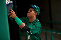 Fort Wayne TinCaps center fielder Jeisson Rosario (18) in the dugout before a game against the West Michigan Whitecaps on May 17, 2018 at Parkview Field in Fort Wayne, Indiana.  Fort Wayne defeated West Michigan 7-3.  (Mike Janes/Four Seam Images)