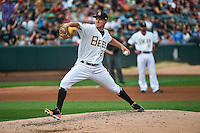 Salt Lake Bees starting pitcher Adam Wilk (29) delivers a pitch to the plate against the Reno Aces in Pacific Coast League action at Smith's Ballpark on July 18, 2015 in Salt Lake City, Utah. The Bees defeated the Aces 6-4. (Stephen Smith/Four Seam Images)