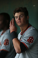 Christian Arroyo (2) of the San Jose Giants in the dugout during a game against the Lancaster JetHawks at The Hanger on April 11, 2015 in Lancaster, California. San Jose defeated Lancaster, 8-3. (Larry Goren/Four Seam Images)