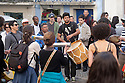 "Lisbon, Portugal. 21.03.2015. A ""Batucada"" Tavern Crawl is held in the Mouraria district of Lisbon. People gather to make music in the streets, accompanied by percussion instruments such as drums, tambourines, etc. whilst revellers follow, dancing, singing, eating and drinking and others watch on from their balconies. ""Batucada"" is a Brazilian form of accompaniment to music such as Samba. It comes from the verb ""Batucar"" which means ""to hammer"". The event is part of a community effort to improve the local area by Mouradia – Casa Comunitária da Mouraria. Photograph © Jane Hobson."