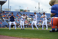 Binghamton Rumble Ponies players, including Scarlyn Reyes (45) and Patrick Biondi (6), dance for an on field promotion during a game against the Hartford Yard Goats on July 9, 2017 at NYSEG Stadium in Binghamton, New York.  Hartford defeated Binghamton 7-3.  Wearing jersey 16 is a performer with the Zooperstars.  (Mike Janes/Four Seam Images)