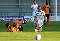 Pictured: Oliver McBurnie of Swansea City (R) having been brought down by Dan Sweeney of Barnet. Wednesday 12 July 2017<br /> Re: Pre-season friendly, Barnet v Swansea City FC at The Hive, London, UK