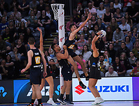 Silver Ferns goalshoot Maia Wilson shoots under pressure during the Cadbury Netball Series final between NZ Silver Ferns and NZ Men at the Fly Palmy Arena in Palmerston North, New Zealand on Saturday, 24 October 2020. Photo: Dave Lintott / lintottphoto.co.nz