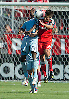 August 18, 2012: Sporting KC midfielder Julio Cesar #55 and Toronto FC forward Andrew Wiedeman #32 in action during an MLS game between Toronto FC and Sporting Kansas City at BMO Field in Toronto, Ontario Canada..Sporting Kansas City won 1-0.