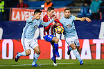 Fernando Torres (c) of Atletico de Madrid fights for the ball with Jonathan Castro Otto Jonny (r) and Facundo Roncaglia of RC Celta de Vigo during their La Liga match between Atletico de Madrid and RC Celta de Vigo at the Vicente Calderón Stadium on 12 February 2017 in Madrid, Spain. Photo by Diego Gonzalez Souto / Power Sport Images