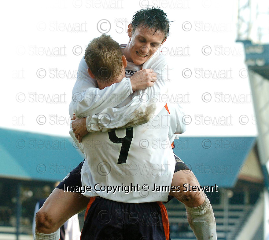 19/03/2005         Copyright Pic : James Stewart.File Name : jspa08_raith_v_falkirk.DAYRLL DUFFY CONGRATULATED DANIEL MCBREEN AS HE CELEBRATES SCORING FALKIRK'S THIRD....Payments to :.James Stewart Photo Agency 19 Carronlea Drive, Falkirk. FK2 8DN      Vat Reg No. 607 6932 25.Office     : +44 (0)1324 570906     .Mobile   : +44 (0)7721 416997.Fax         : +44 (0)1324 570906.E-mail  :  jim@jspa.co.uk.If you require further information then contact Jim Stewart on any of the numbers above.........A