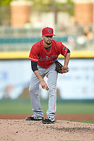 Louisville Bats relief pitcher Jesus Reyes (16) looks to his catcher for the sign against the Charlotte Hornets at BB&T BallPark on June 22, 2019 in Charlotte, North Carolina. The Hornets defeated the Bats 7-6. (Brian Westerholt/Four Seam Images)