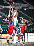 North Texas Mean Green forward Ash'Lynne Evans (1) drives in the ball as South Alabama Jaguars forward Cylenthia Kennon (22) defends her during the NCAA Women's basketball game between the South Alabama Jaguars and the University of North Texas Mean Green at the North Texas Coliseum,the Super Pit, in Denton, Texas. South Alabama defeated UNT 79 to 61.
