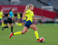 TOKYO, JAPAN - JULY 21: Hanna Glas #4 of Sweden dribbles during a game between Sweden and USWNT at Tokyo Stadium on July 21, 2021 in Tokyo, Japan.