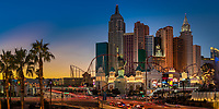 Colorful sunset on the New York, New York Hotel, The Strip with beautiful traffic light trails, and the MGM lion statue, Las Vegas Nevada