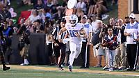 WINSTON-SALEM, NC - SEPTEMBER 13: Jace Ruder #10 of the University of North Carolina runs the ball during a game between University of North Carolina and Wake Forest University at BB
