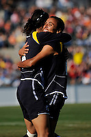Marta Vieira da Silva (10) celebrates scoring her first goal with Han Duan (9). The Los Angeles Sol defeated Sky Blue FC 2-0 during a Women's Professional Soccer match at TD Bank Ballpark in Bridgewater, NJ, on April 5, 2009. Photo by Howard C. Smith/isiphotos.com