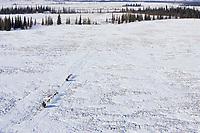 Aerial of two teams travelling together between Kaltag & Unalakleet
