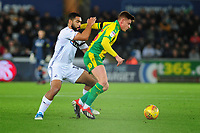 Cameron Carter-Vickers of Swansea City battles with Harvey Barnes  of West Bromwich Albion during the Sky Bet Championship match between Swansea City and West Bromwich Albion at the Liberty Stadium in Swansea, Wales, UK. Wednesday 28 November 2018