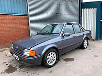 BNPS.co.uk (01202 558833)<br /> Pic: HampsonAuctions/BNPS<br /> <br /> Pictured: 1988 Ford Orion 1.6i.<br /> <br /> Since the 1990s, Geoff Barlow, 46, has collected dozens of classic cars from an Escort Mexico replica to several types of Transit, Cortina, and Sierra.<br /> <br /> However, he still regrets selling the first car which inspired his passion, a 1980 Escort Mark 2 he bought from his sister in 1992.  <br /> <br /> Geoff's fascination with Fords gathered pace in the last decade and he 'lost control,' buying as many Fords as he came across and saving them from disrepair.