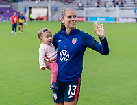 ORLANDO, FL - FEBRUARY 21: Alex Morgan #13 of the USWNT waves to the fans in the crowd after a game between Brazil and USWNT at Exploria Stadium on February 21, 2021 in Orlando, Florida.