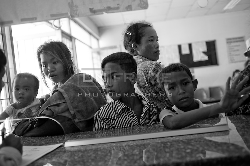Cambodian familly at the reception of National Pediatric Hospital of Phnom Penh. Cambodia