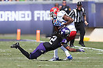 TCU Horned Frogs cornerback  Jason Verrett (2) tackles Kansas Jayhawks wide receiver Christian Matthews (12) during the game between the Kansas Jayhawks and the TCU Horned Frogs  at the Amon G. Carter Stadium in Fort Worth, Texas. TCU defeats Kansas 27 to 17.
