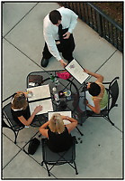 Lifestyle photography of people dining in mixed-use development Birkdale Village, a suburban shopping center located north of Charlotte, NC, in Huntersville, NC. Birkdale Village is one of the country's first mixed-use developments. The center, anchored by shopping and restaurants, was developed by Pappas Properties.