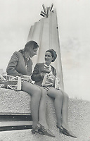 The miniskirt came to Canada for Expo. Left: two leggy beauties pause for a rest outside the U.K. pavilion.<br /> <br /> 1967<br /> <br /> PHOTO :  Dick Darrell - Toronto Star Archives - AQP