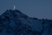 Moonrise over Pioneer Peak, Alaska. Photo by James R. Evans