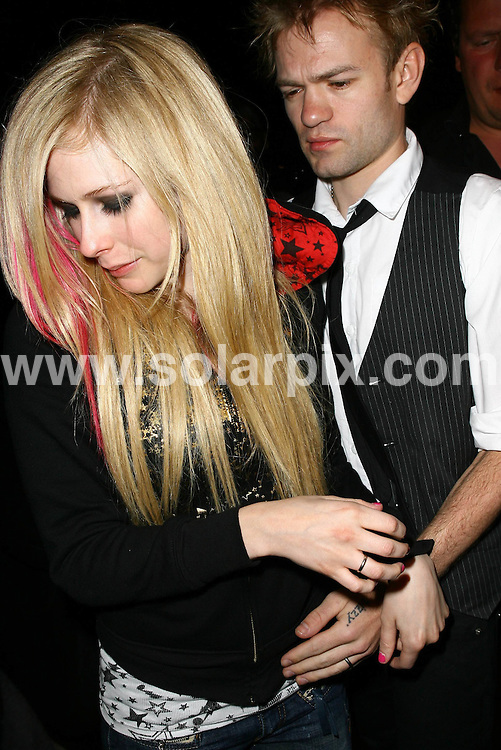 **ALL ROUND PICTURES FROM SOLARPIX.COM**.**WORLDWIDE SYNDICATION RIGHTS**.**NO PUBLICATION IN AUSTRALIA, DENMARK, GERMANY, NEW ZEALAND, RUSSIA, UK OR USA**.Avril Lavigne and husband Deryck Whibley seen leaving Koi Restaurant in West Hollywood, California, USA. 23rd August 2008..This pic: Avril Lavigne and Deryck Whibley..JOB REF: 7110 LAP/VIP HD       DATE: 23_08_2008.**MUST CREDIT SOLARPIX.COM OR DOUBLE FEE WILL BE CHARGED* *UNDER NO CIRCUMSTANCES IS THIS IMAGE TO BE REPRODUCED FOR ANY ONLINE EDITION WITHOUT PRIOR PERMISSION*