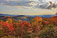 "Fall scenic view from Blue Ridge Mountains near Asheville with clouds, fall colors and ""God Rays"""