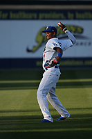 Yusniel Diaz (21) of the Rancho Cucamonga Quakes throws in the outfield before a game against the Modesto Nuts at LoanMart Field on June 5, 2017 in Rancho Cucamonga, California. Rancho Cucamonga defeated Modesto, 7-5. (Larry Goren/Four Seam Images)