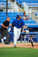 Dunedin Blue Jays designated hitter Bo Bichette (10) runs to first base as home plate umpire J.C. Velez follows the play during a game against the Bradenton Marauders on July 17, 2017 at Florida Auto Exchange Stadium in Dunedin, Florida.  Bradenton defeated Dunedin 7-5.  (Mike Janes/Four Seam Images)