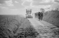 a group behind is caught in the dust of overtaking team cars<br /> <br /> 33th Tro Bro Léon 2016