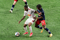 FOXBOROUGH, MA - MAY 22: Kyle Duncan #6 of New York Red Bulls dribbles as DeJuan Jones #24 of New England Revolution defends during a game between New York Red Bulls and New England Revolution at Gillette Stadium on May 22, 2021 in Foxborough, Massachusetts.