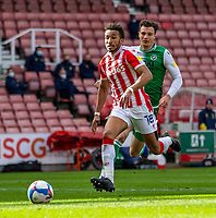 5th April 2021; Bet365 Stadium, Stoke, Staffordshire, England; English Football League Championship Football, Stoke City versus Millwall; Jacob Brown of Stoke City chases a loose ball