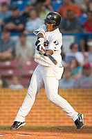 Winston-Salem shortstop Victor Mercedes connects with the ball in game action versus Lynchburg at Ernie Shore Field in Winston-Salem, NC, Saturday, June 3, 2006.  Winston-Salem defeated Lynchburg 3-2.
