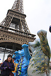 Beth viewing artwork at the Eiffel Tower, Paris France.