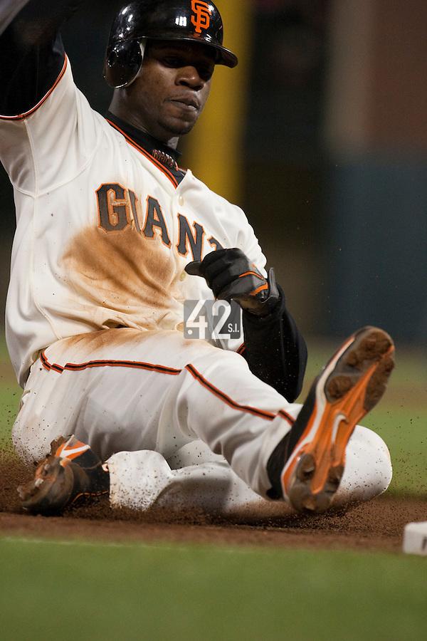 17 April 2009: San Francisco Giants' Fred Lewis slides on third base during the San Francisco Giants' 2-0 win against the Arizona Diamondbacks at AT&T Park in San Francisco, CA.