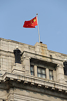 A Chinese national flag flying over a building on the Bund.<br /> <br /> To license this image, please contact the National Geographic Creative Collection:<br /> <br /> Image ID: 2169169 <br /> <br /> Email: natgeocreative@ngs.org<br /> <br /> Telephone: 202 857 7537 / Toll Free 800 434 2244<br /> <br /> National Geographic Creative<br /> 1145 17th St NW, Washington DC 20036