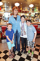 """NO REPRO FEE. 26/5/2011. NEW EDDIE ROCKET'S SHAKE SHOP. Liz O Brien, Spencer O Connor, Heather O Connor and Jordan O Connor are pictured in the new Eddie Rocket's Shake Shop. The design seeks to recall the vintage milkshake bars from 1950's America and re-imagine them for the 21st century. The new look aims to appeal to both young and old with a quirky and bold colour scheme and a concept of make-your-own milkshakes, based on the tag line """"You make it...We shake it!"""". Eddie Rocket's City Diner in the Stillorgan Shopping Centre in south Dublin has re-opened after an exciting re-vamp and the addition of a Shake Shop. Ten new jobs have been created with the Diner's re-launch bringing the total working in Eddie Rocket's Stillorgan to 30. Picture James Horan/Collins Photos"""