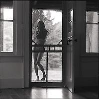 Nude figure in doorway