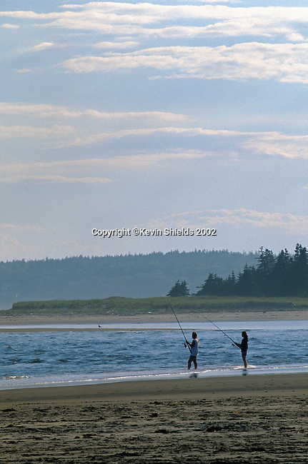 Two people fishing at Popham Beach State Park, Maine, USA